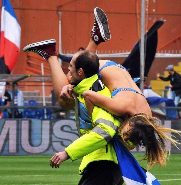 Attractive female streaker carried off by steward during Sampdoria v Napoli! [Pictures]