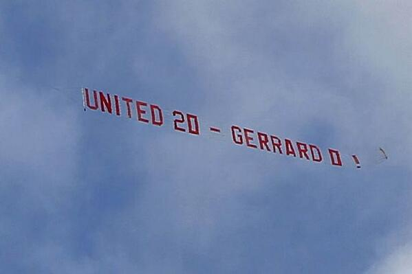 'United 20 Gerrard 0': Manchester United fans taunt Liverpool captain with banner flown over Anfield. http://t.co/jpelYn2D5w