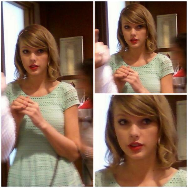 Taylor's face when everyone in the room stood up and walked toward her at the beginning.
