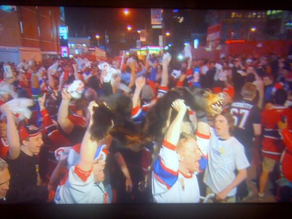 Canadiens fans carry bear skin through streets after win