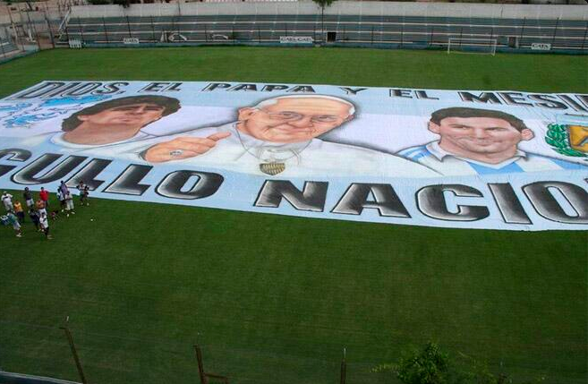 Argentina have a huge banner for the World Cup featuring Diego Maradona, the Pope & Lionel Messi [Picture]