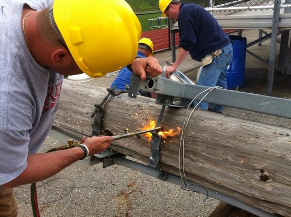 Brian Mower uses a blow torch to cut the metal fasteners on #grigglites @MercuryX http://t.co/kzmQBHrs6O