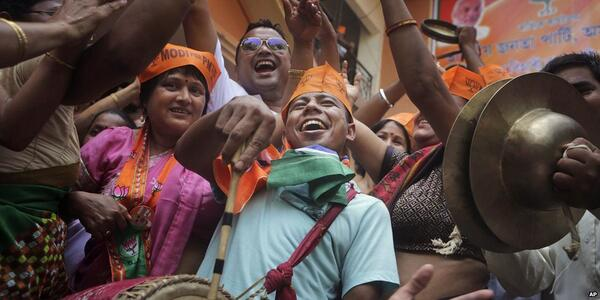 BJP supporters celebrate as #Results2014 suggest landslide #IndiaElections win http://t.co/m1NNeVr08x & http://t.co/q3GkX514cn