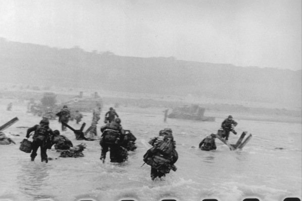 Robert Capa's Iconic D-Day Photo of a Soldier in the Surf http://t.co/J3xDGMwEQu #dday #photography http://t.co/iR5FlUjRGW
