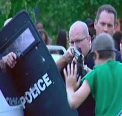 "Aurora Police being sued for a ""more-than-2-hr mass roundup of innocent men, women & children"" http://t.co/2VNz7p1Vp5 http://t.co/4KPJFKCgCa"