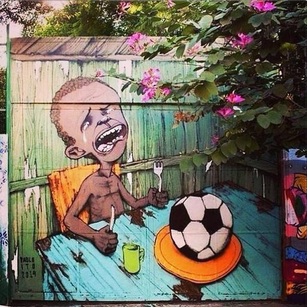 This Brazilian graffiti piece protesting the World Cup is quickly becoming both viral and iconic. http://t.co/UuKYCZNnex