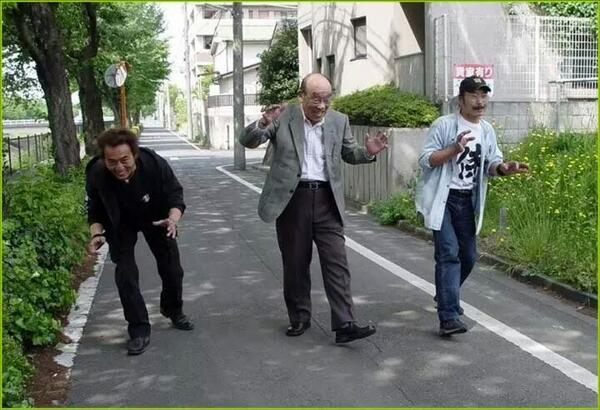 All 3 generations of Godzilla suit wearers walking down the street together http://t.co/xHUTOT62ji http://t.co/T6NRoYyXNN