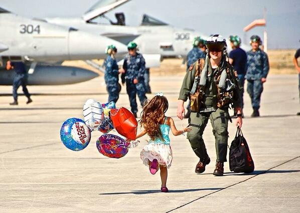One of my best friends growing up is a Navy fighter pilot. His daughter greeting him after a mission is priceless. http://t.co/0ji2DLlF7y