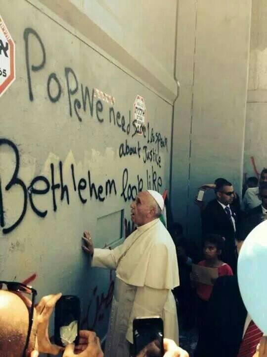 The @Pontifex expression in this photo is priceless #Bethlehem #PopeInPalestine #ApartheidWall http://t.co/vUx4H4FBj3