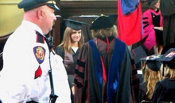 Why are @EmWatson's fellow English grads (at right) wearing IXs & red 0s on their caps? http://t.co/NoCCafIc4b … … http://t.co/ogabBEsU6p