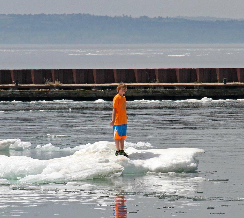 Kid on iceberg Monday at Madeline Island harbor. Not sure how he got there but boat picked him up http://t.co/hHjxVfjr1U
