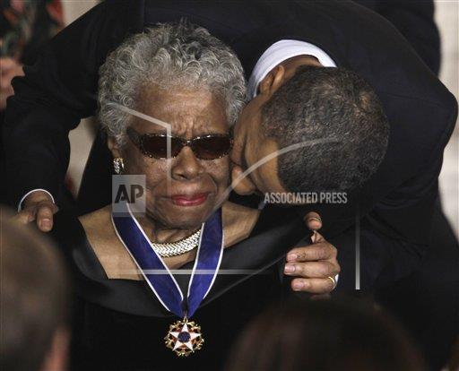 Obama kisses Maya Angelou after awarding her the Medal of Freedom in 2011 via @AP_Images http://t.co/TX9zcKymby