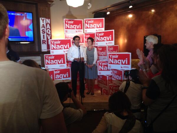 .@Yasir_Naqvi gives his victory speech with his wife Christine at the Clocktower on Richmond Rd. #cbcott #voteon http://t.co/qtqawxaxCV