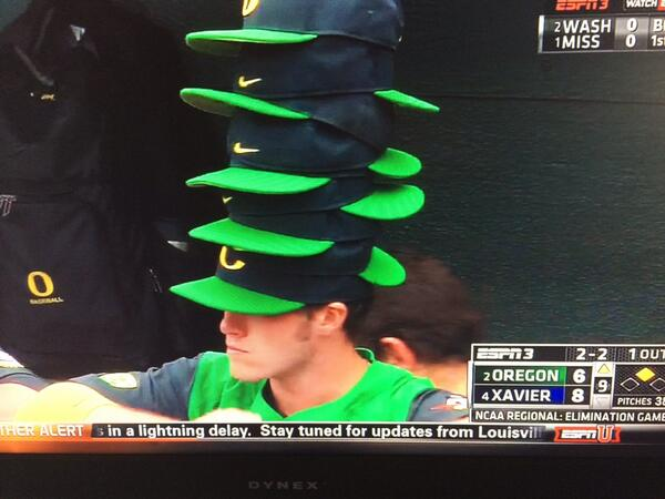 oregon baseball caps nike ducks hat state player wears rally stack of hats photo sports videos highlights