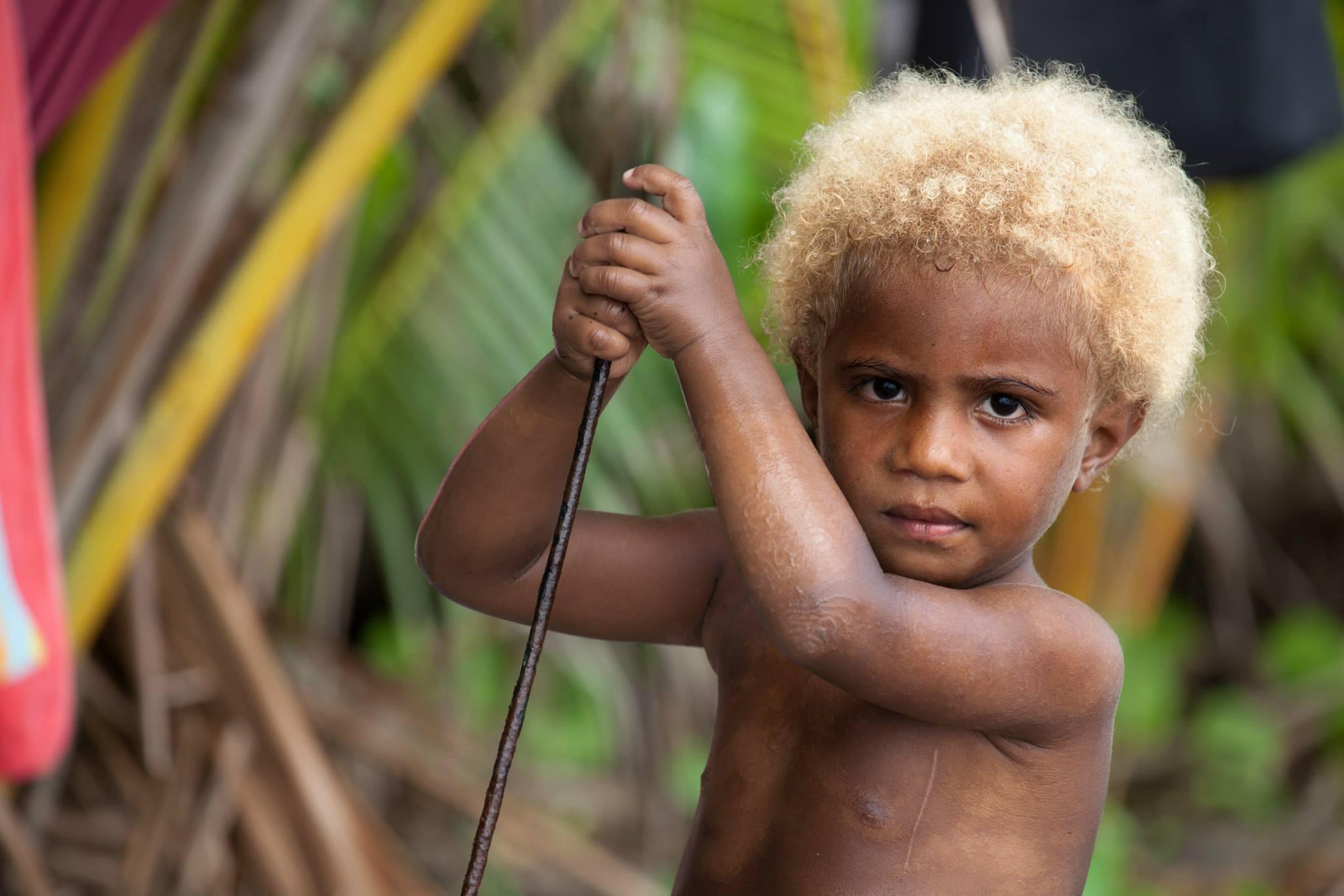 Kanak (Melanesian) girl on the beach at Mebuet, island of