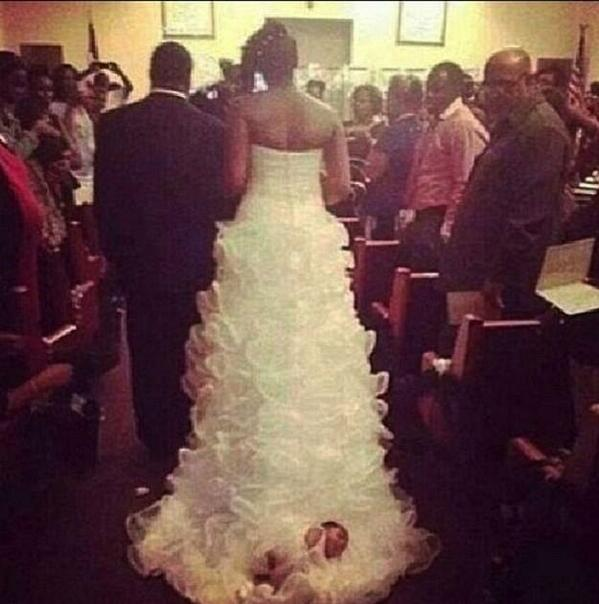 Woman ties baby to wedding dress, drags her down aisle
