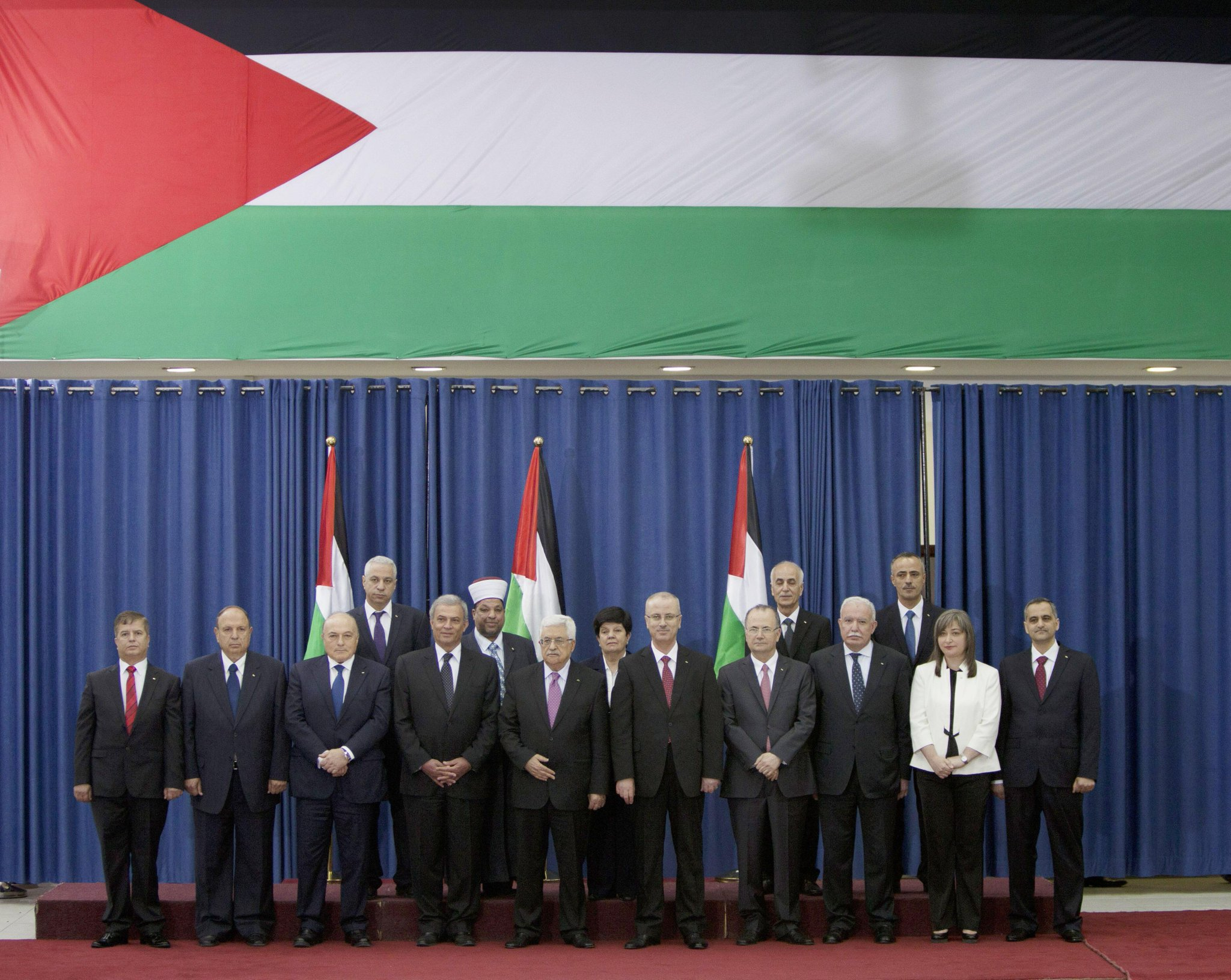 Group portrait of Palestinian President Mahmoud Abbas with the new Palestinian Government