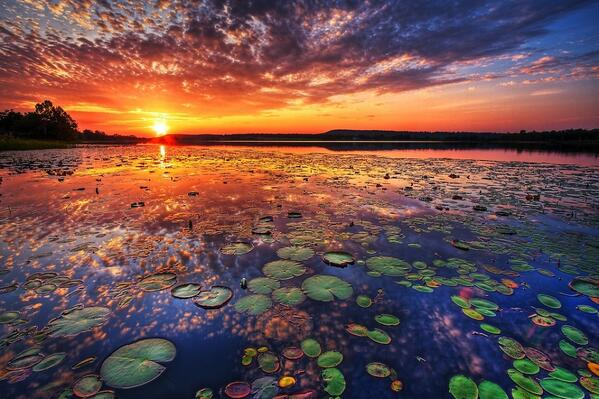 An amazing sunset across a lake. The sky lights up at sunset.. http://t.co/CEIHAKbELf