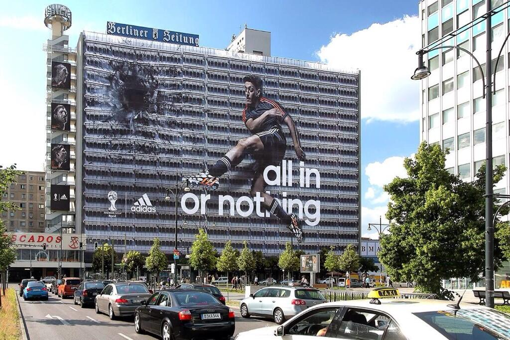 There is a massive new Adidas poster of Arsenals Mesut Ozil destroying a building in Germany [Pictures]