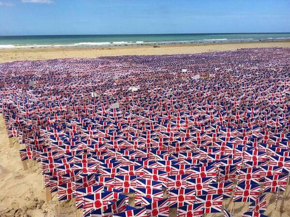 22,000 Union flags reading 'Thank You' laid in memory of D-Day veterans on Gold Beach in Normandy. #DDay70. http://t.co/tmki6wkzOk