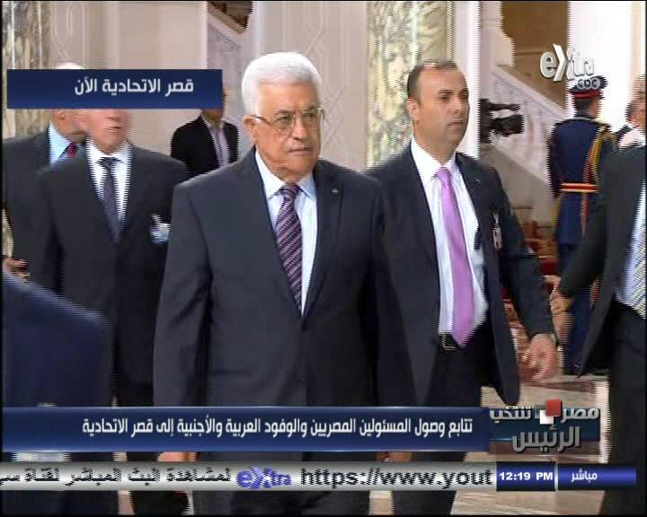President Mahmoud Abbas followed by security + by Saeb Erekat attend Sisi inaugural reception in Cairo