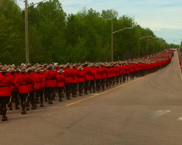 What a picture. Holy holy. @RCMPPEITraffic March to Moncton Coliseum to pay final salute to their fallen brethren http://t.co/tLHiNAzBk8