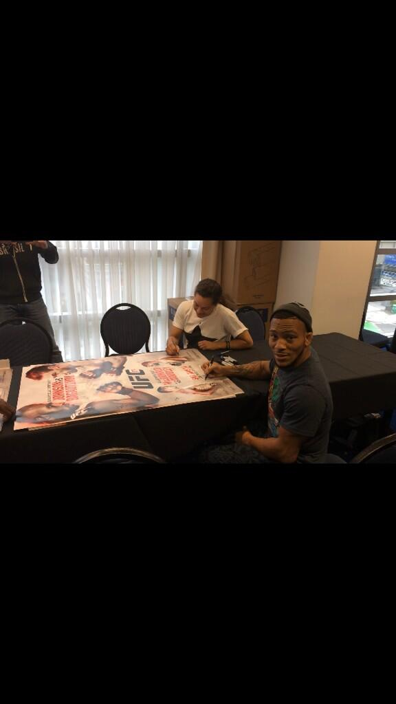 UFC174 I'm here signing posters @ufc http://t.co/vcvCxdQa5h