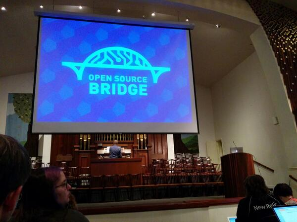 Keynote for #osbridge is in a church with an organ playing the Mario theme. This is going to be a good week. http://t.co/ijX8YK4ZQi