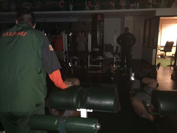 Coach @GoldenAl looks on as #Canes linemen stretch to begin #RISEandGRIND http://t.co/CTUW2psYZj