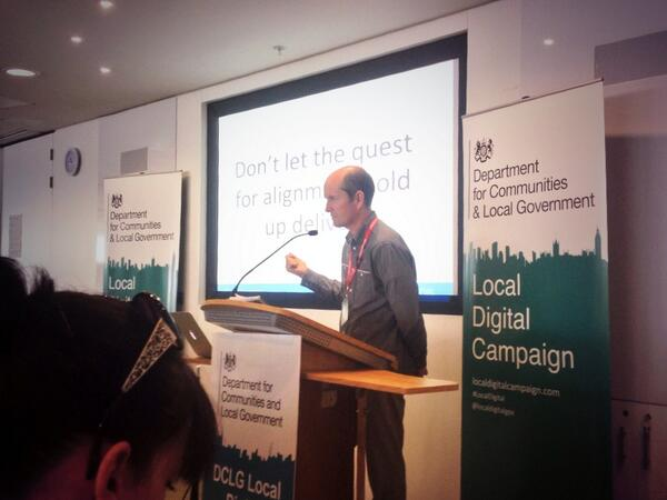 Behind Ben Hayman it says 'don't let the quest for alignment hold up delivery' #LDdiscovery #LocalDigital http://t.co/SFJKnpx2zz