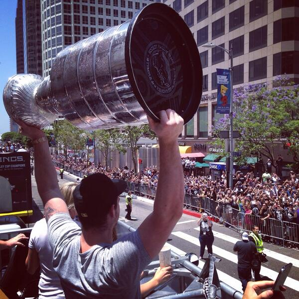 The one and only @Jonathanquick32 hoisting the cup at the parade! #YouWereYouAreUMASS RT @LAKings: Quick and the cup http://t.co/vVSnRLj0Ph