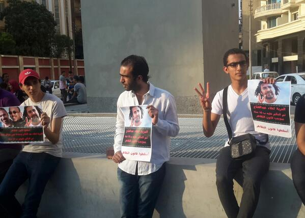 Freedom for detainees. Three finger sign = against Mubarak, military rule & the MB. #NoProtestLaw #Egypt http://t.co/PtyQbeJBn2