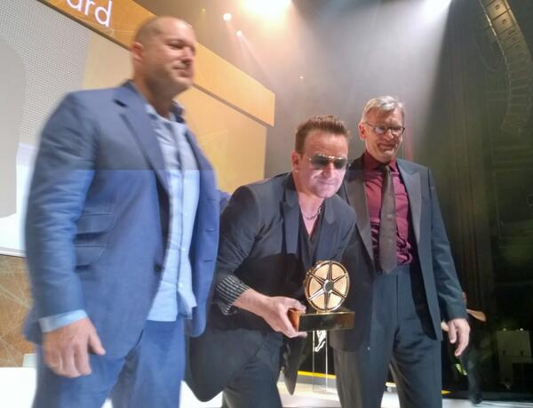 Jonathan Ive presents the first Cannes LionHeart Award to Bono for his pioneering work with @RED #CannesLions http://t.co/yUdVEDXXV0