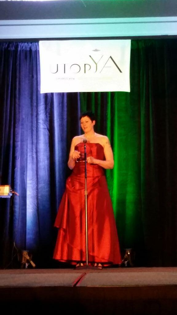 That's my chick rocking it!! Congrats to @Toni_BookAddict for winning Best Book Blog of the Year!! #utopya2014 http://t.co/wnHFv3nBuw
