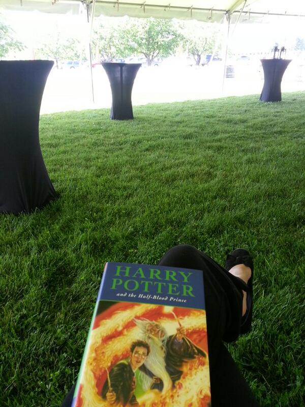 Since I was so early for my #NIFF2014 volunteer shift yesterday, I was able to read in the tent. #HPreread http://t.co/6g0GpJW8hD