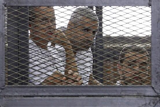 The look on their faces says so much. Our updated story on the Al Jazeera trial verdict here http://t.co/zkoofcwuDj http://t.co/zWPU7a4jvu