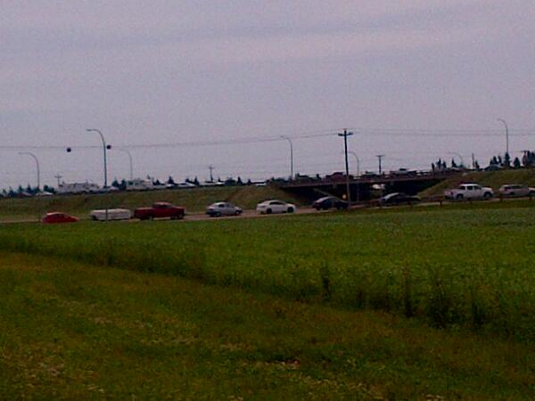 If u r heading to the Confederation Bridge, be prepared to wait. Traffic backed up 7-8 kms to the Albany Y. http://t.co/uwAOGxduue