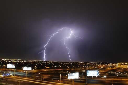 Lightning Strikes West Las Vegas during a thunderstorm on July 6th 2014. Photos by @702Web #LightningStorm #rain http://t.co/YWAsDMBDMB
