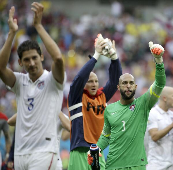 Tim Howard celebrates the United States' qualification after a 1-0 loss to Germany. (@Everton/Twitter)