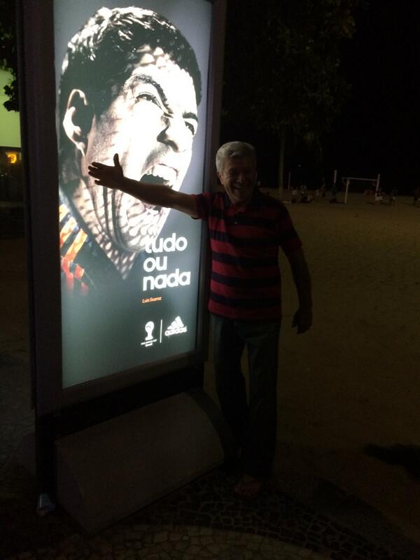 People are queuing up to get their photos taken with the Suarez adverts on the Copacabana. #bbcworldcup http://t.co/f7TNxGiXTL