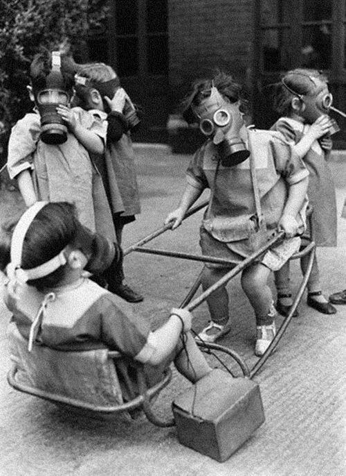 "History In Pictures on Twitter: ""Children wearing gas masks while ..."