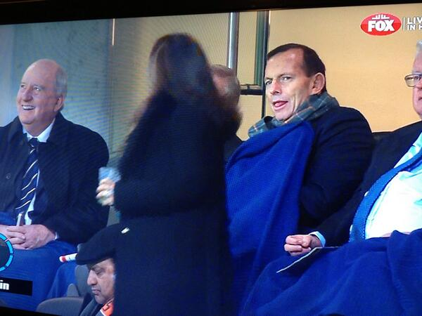 Tony Abbott at #AFLSwansGiants - not quite a wink but still a mildly disturbing look on his face as a lady walks past http://t.co/4Le4nbeeeY