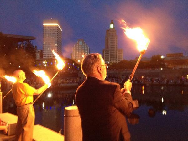 Lighting WaterFire. #WaterFire #PVD http://t.co/jXQaHXH2Xz
