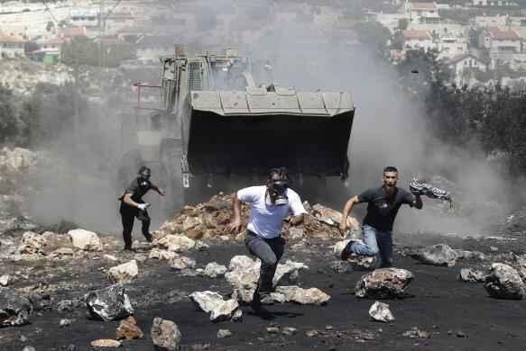 "#Palestine #Repression ""@ajamazing: Protesters run in front of Israeli military bulldozer in #WestBank, near #Nablus http://t.co/aqYkLV5nmD"""