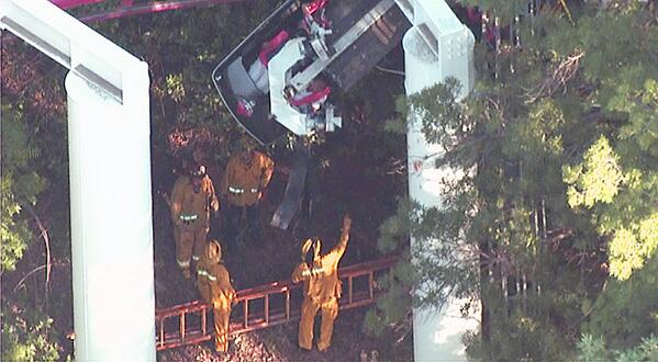 Firefighter assess stuck train car on Ninja ride at Magic Mountain. http://t.co/EHIn0RSmf8 http://t.co/WLaD9pAzyQ