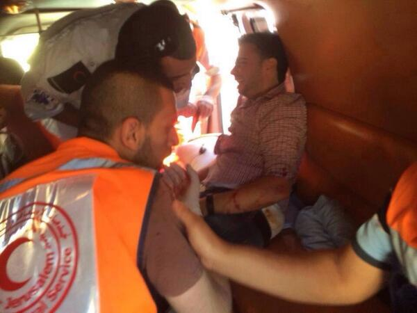 Photos showing Palestine TV crew injured while covering Shu'fat clashes. They were shot by Israeli forces! Via @QudsN http://t.co/9PmPLSKkIQ