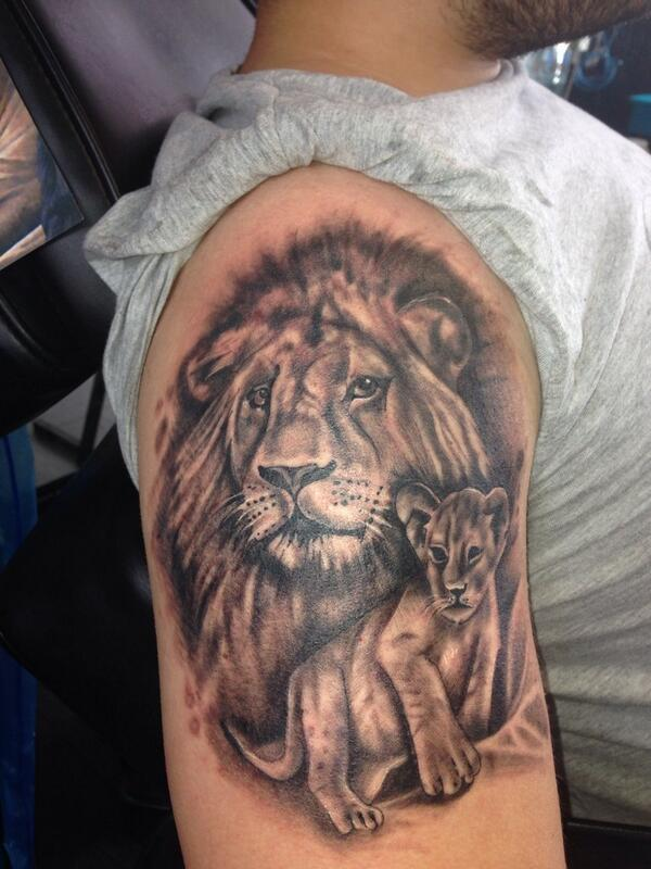 Enjoyed doing this lion and cub tattoo representing for Father son tattoos