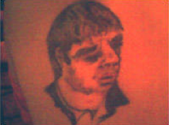 Thanks to Si in Rochdale, here's an unfortunate Noel Gallagher tattoo... http://t.co/Diu3HjSNwt