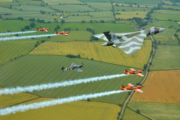 Wednesday's formation flight with passengers alongside @XH558 and a Spitfire. #unforgettable http://t.co/0lDDdIUxQd