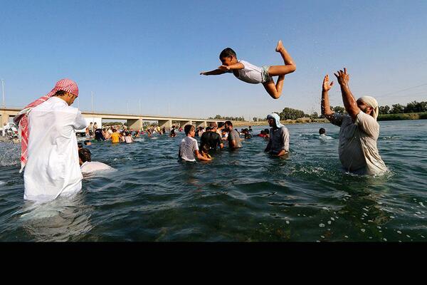 "Tamer Yazar on Twitter: ""Residents swim in the #Euphrates ..."